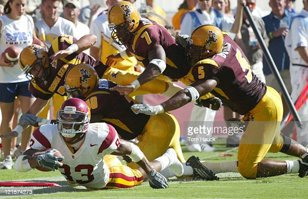 Keary Colbert of the USC Trojans is tackled by the Arizona State Sun Devils defense at Sundevil Stadium in TempeAZ USC won 3717