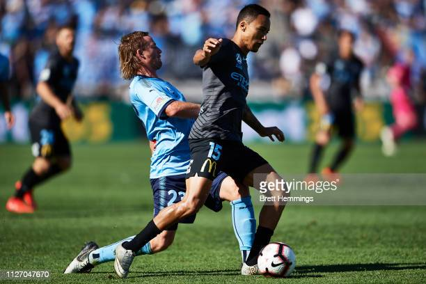 Kearyn Baccus of Melbourne City is tackled by Rhyan Grant of Sydney during the round 17 ALeague match between Sydney FC and Melbourne City at WIN...