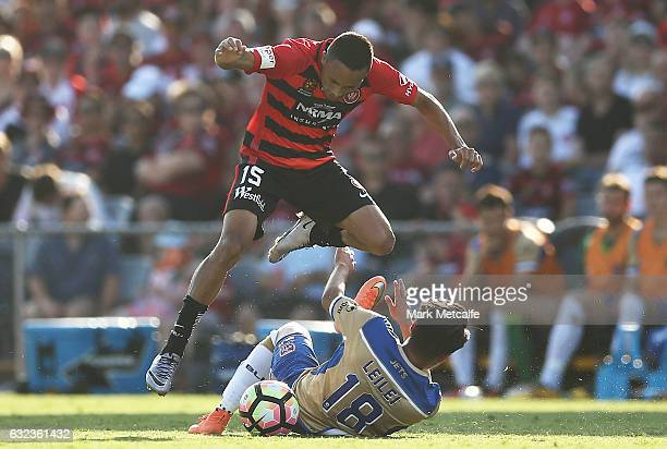 Kearyn Baccus of the Wanderers is tackled by Ma Leilei of the Jets during the round 16 ALeague match between the Western Sydney Wanderers and the...