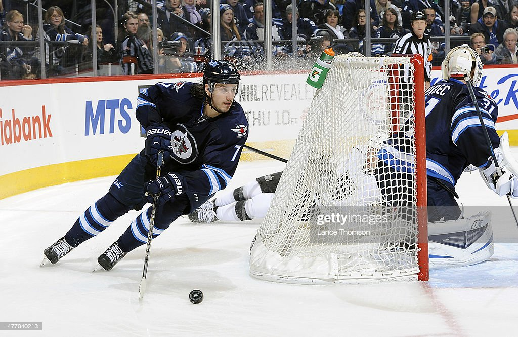 Keaton Ellerby #7 of the Winnipeg Jets plays the puck around the net during third period action against the Los Angeles Kings at the MTS Centre on March 6, 2014 in Winnipeg, Manitoba, Canada. This was Ellerby's 200th career NHL game.