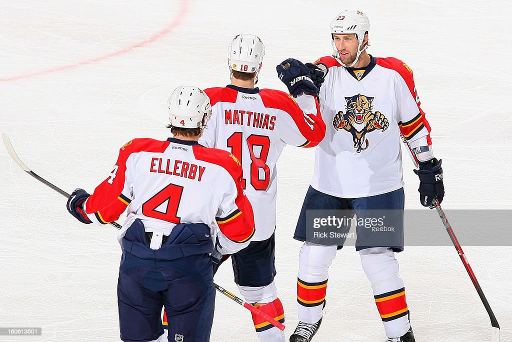 Keaton Ellerby #4, Shawn Matthias #18 and Tyson Strachan #23 of the Florida Panthers celebrate Matthias' goal in the first period against the Buffalo Sabres at First Niagara Center on February 3, 2013 in Buffalo, New York.