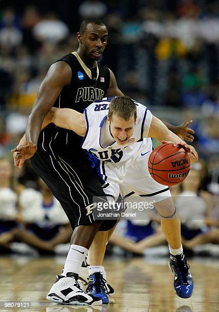 Keaton Grant of the Purdue Boilermakers fouls Jon Scheyer of the Duke Blue Devils during the south regional semifinal of the 2010 NCAA men's...
