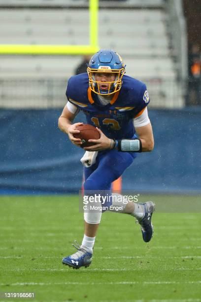 Keaton Heide of the South Dakota State Jackrabbits scrambles against the Sam Houston State Bearkats sduring the Division I FCS Football Championship...