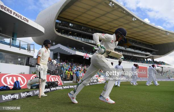 Keaton Jennings and Rory Burns of England go out to bat during Day Four of the First Test match between England and West Indies at Kensington Oval on...
