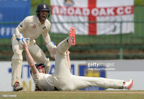 Keaton Jennings celebrates with Ben Foakes of England after catching Dhananjaya de Silva of Sri Lanka during the 2nd Cricket Test Match between Sri...