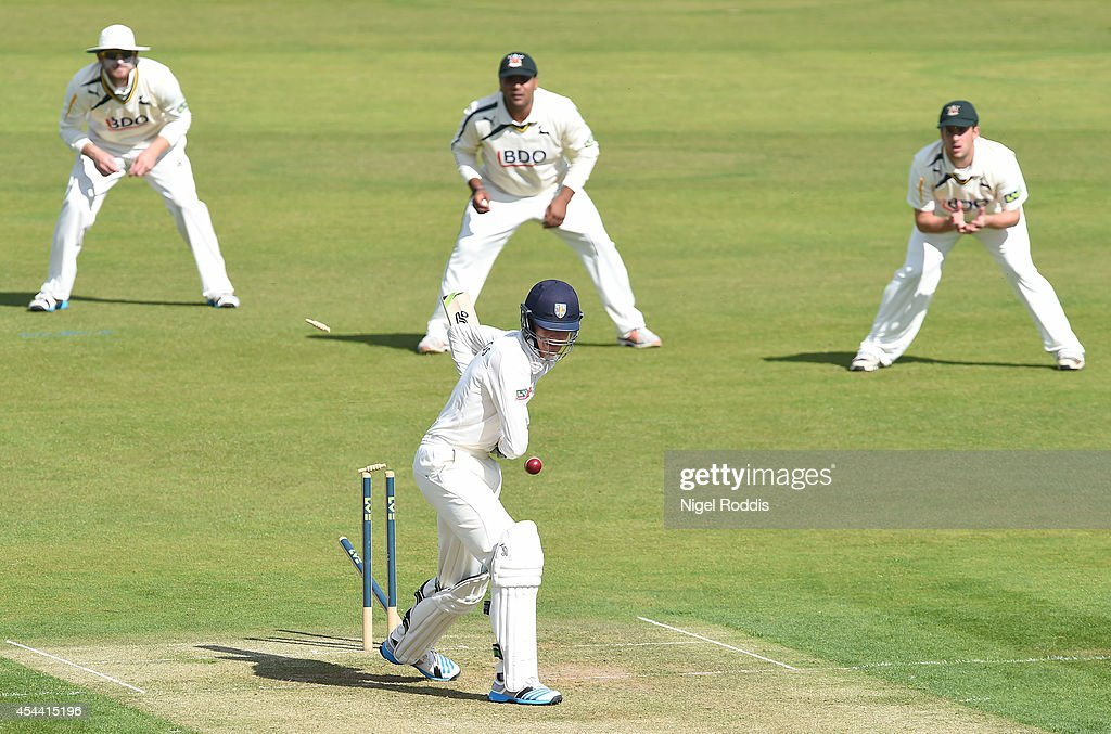Keaton Jennings (C) of Durham is bowled ot by Ajmal Shahzad (unseen) during the LV County Championship match between Durham and Nottinghamshire at The Riverside on August 31, 2014 in Chester-le-Street, England.