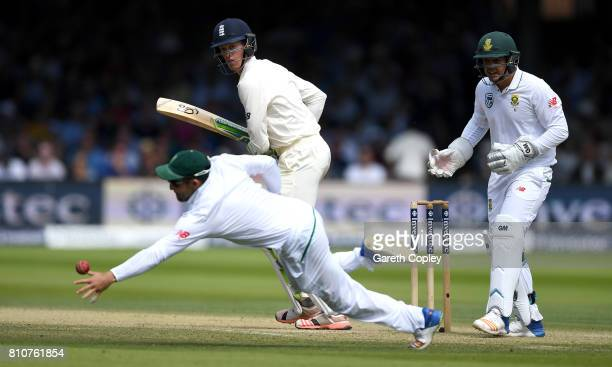 Keaton Jennings of England hits past Dean Elgar of South Africa during day three of the 1st Investec Test match between England and South Africa at...