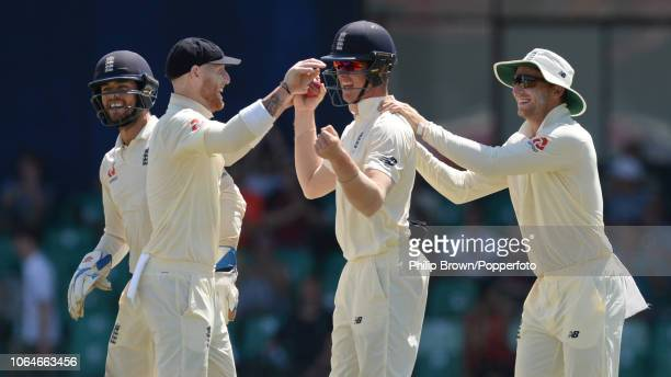 Keaton Jennings of England is congratulated by Ben Stokes and Jos Buttler after Danushka Gunathilaka of Sri Lanka during second day of the 3rd...