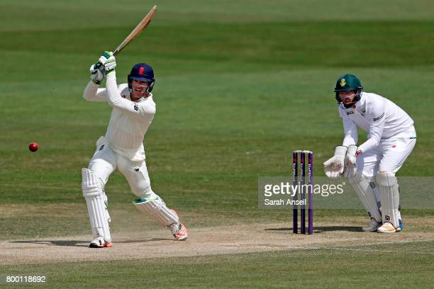 Keaton Jennings of England Lions hits out as South Africa A wicket keeper Heinrich Klaasen looks on during day 3 of the match between England Lions...