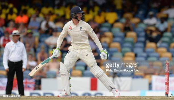 Keaton Jennings of England looks on after being dismissed during the fourth day of the first Test match between the West Indies and England at...