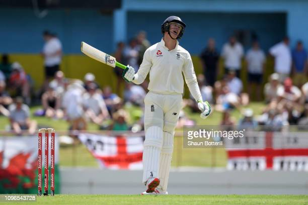 Keaton Jennings of England reacts after being caught behind off the bowling Keemo Paul of West Indies during Day One of the Third Test match between...