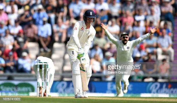 Keaton Jennings of England reacts after being dismissed by Mohammed Shami of India during day three of the Specsavers 4th Test match between England...