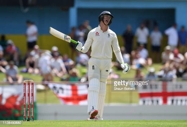 Keaton Jennings of England reacts after losing his wicket during Day One of the Third Test match between the West Indies and England at Daren Sammy...