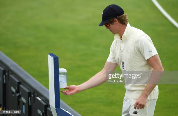 Keaton Jennings of England uses a pitch-side hand sanitation point during Day One of a England Warm Up Match at the Ageas Bowl on July 01, 2020 in...