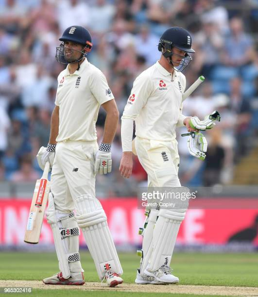Keaton Jennings of England walks past Alastair Cook as he leaves the field after being dismissed by Faheem Ashraf of Pakistan during the 2nd NatWest...