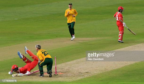 Keaton Jennings of Lancashire dives to make his ground as Tom Moores of Notts attempts to run him out during the Vitality T20 Blast Semi Final...