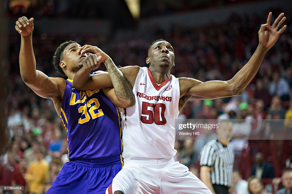 Keaton Miles #50 of the Arkansas Razorbacks blocks out for a rebound against Craig Victor II #32 of the LSU Tigers at Bud Walton Arena on February 23, 2016 in Fayetteville, Arkansas. The Razorbacks defeated the Tigers 85-65,