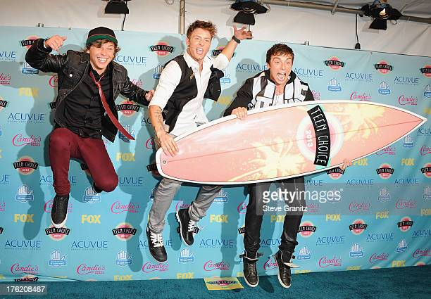 Keaton Stromberg Drew Chadwick and Wesley Stromberg of Emblem3 pose in the press room at the 2013 Teen Choice Awards at Gibson Amphitheatre on August...