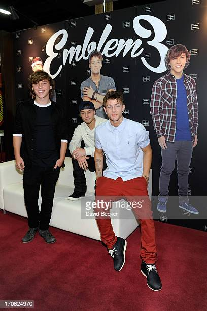 Keaton Stromberg, Wesley Stromberg and Drew Chadwick of Emblem3 appear at the Live Nation merchandise booth at Licensing Expo 2013 at the Mandalay...