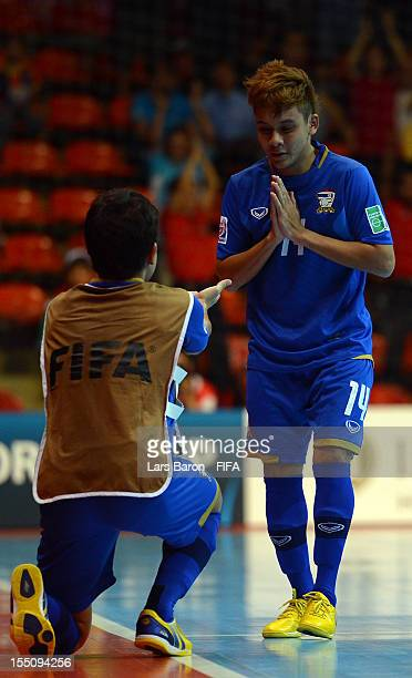 Keattiyot Chalaemkhet of Thailand celebrates after scoring his teams first goal during the FIFA Futsal World Cup Group A match between Thailand and...