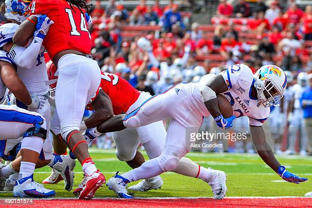 Ke'aun Kinner of the Kansas Jayhawks dives for a touchdown in the third quarter during a game against the Rutgers Scarlet Knights at High Point...