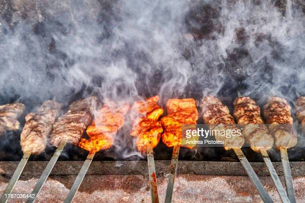 kebab grill in uzbekistan - muziek stock pictures, royalty-free photos & images