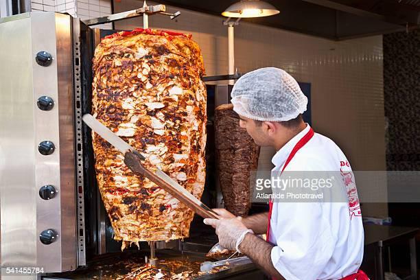 Kebab vendor slicing meat