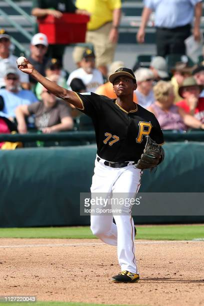 Ke'Bryan Hayes of the Pirates throws the ball over to first base during the spring training game between the Miami Marlins and the Pittsburgh Pirates...