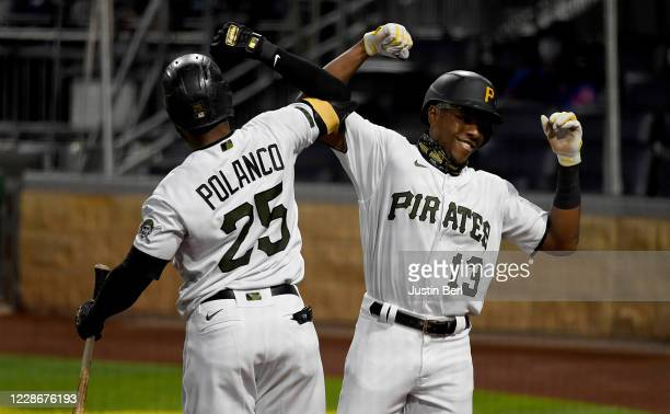 Ke'Bryan Hayes of the Pittsburgh Pirates celebrates with Gregory Polanco after hitting a solo home run in the first inning during the game against...