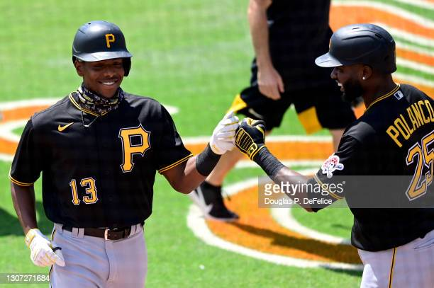 Ke'Bryan Hayes of the Pittsburgh Pirates celebrates with teammate Gregory Polanco after hitting a solo home run during the first inning against the...