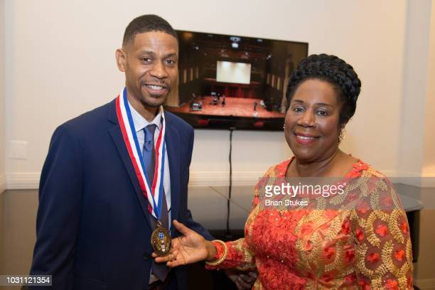 Kecalf Franklin Son of Aretha Franklin and Congresswoman Sheila Jackson Lee pose with Legacy Award presented to Aretha Franklin tonight during...