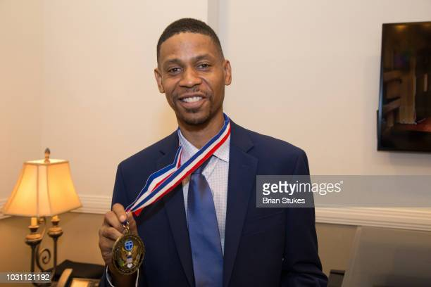 Kecalf Franklin Son of Aretha Franklin poses with the Legacy Award he accepted on behalf of his mom during 'Evolution of Gospel A Tribute to Aretha...