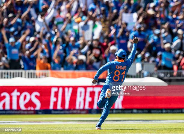 Kedar Jadhav of India celebrates in front of the India supporters after taking a catch to dismiss Chris Gayle of West Indies during the Group Stage...