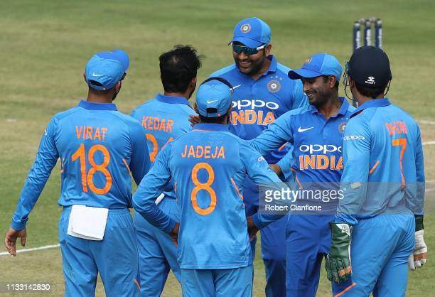Kedar Jadhav of India celebrates taking the wicket of Marcus Stoinis of Australia during game one of the One Day International series between India...