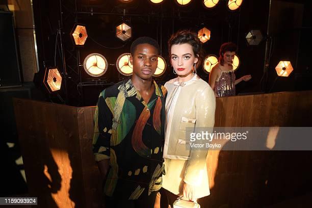 Kedar Williams Stirling and Emma MacKey attend Miu Miu Club event at Hippodrome d'Auteuil on June 29 2019 in Paris France
