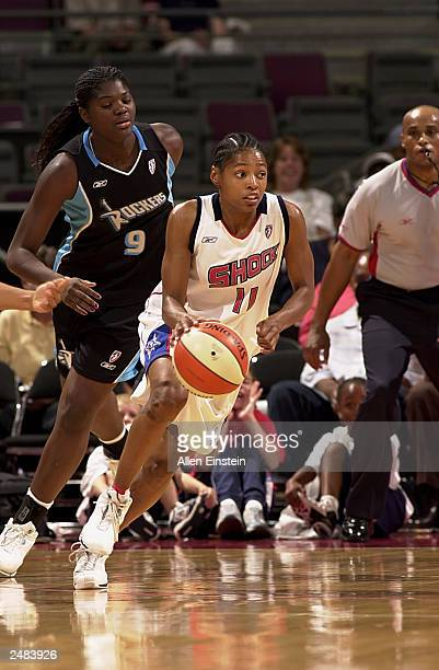 Kedra HollandCorn of the Detroit Shock drives past Lucienne Berthieu of the Cleveland Rockers in Game three of the Eastern Conference Semifinals...