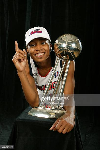 Kedra HollandCorn of the Detroit Shock poses with the 2003 WNBA Championship trophy and the Finals MVP award after Game three of the 2003 WNBA Finals...