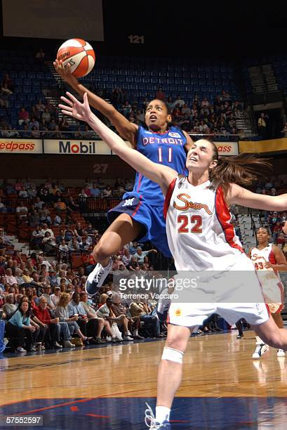 Kedra HollandCorn of the Detroit Shock shoots against Jessica Brungo of the Connecticut Sun at Mohegan Sun Arena May 7 2006 in Uncasville Connecticut...
