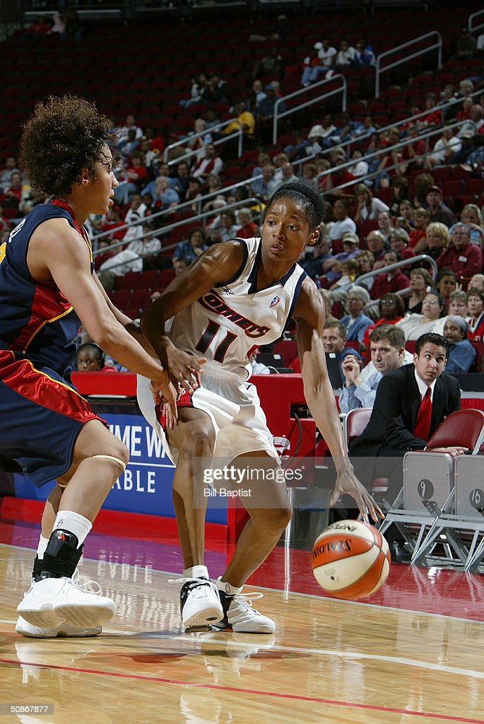 Kedra Holland-Corn #11 of the Houston Comets dribbles to the basket against the Connecticut Sun during the preseason game at Toyota Center on May 11, 2004 in Houston, Texas. The Comets won 84-71.
