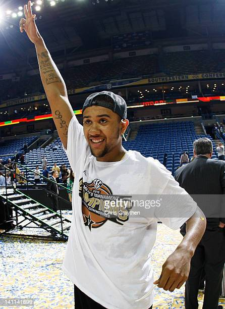 Kedren Johnson of the Vanderbilt Commodores celebrates their 71 to 64 win over the Kentucky Wildcats in the championship game of the 2012 SEC Men's...