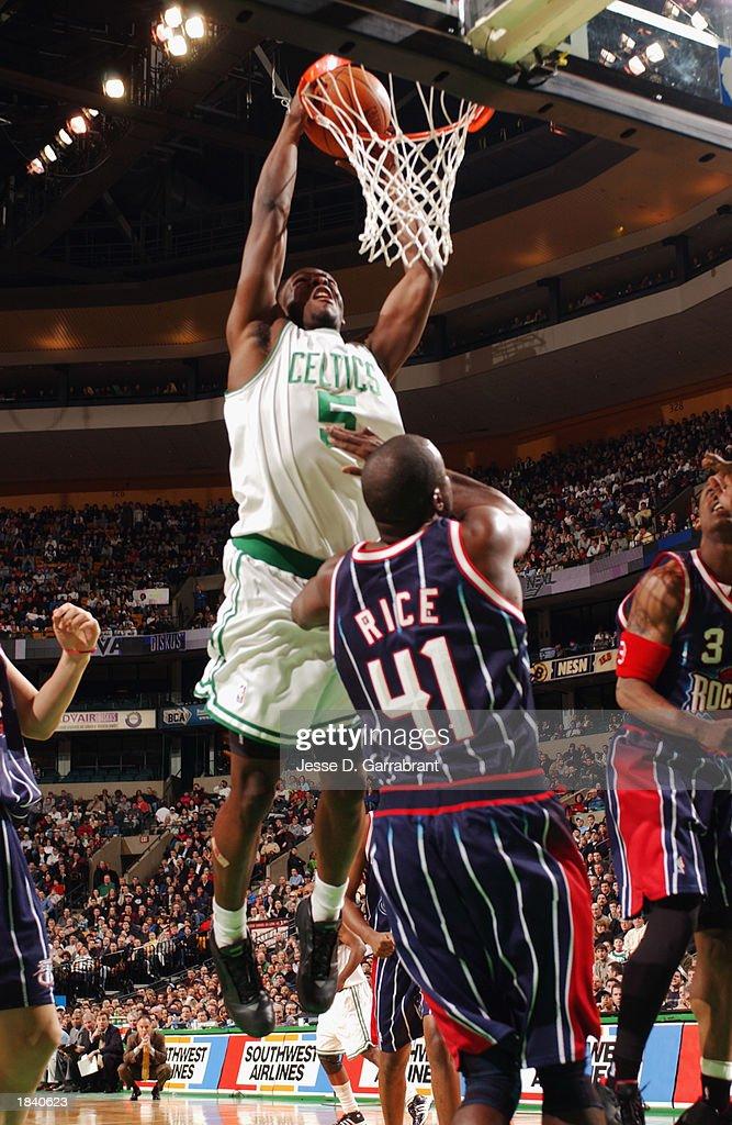 Kedrick Brown #5 of the Boston Celtics dunks over Glen Rice #41 of the Houston Rockets during the NBA game at Fleet Center on February 24, 2003 in Boston, Massachusetts. The Rockets won in overtime 101-95.