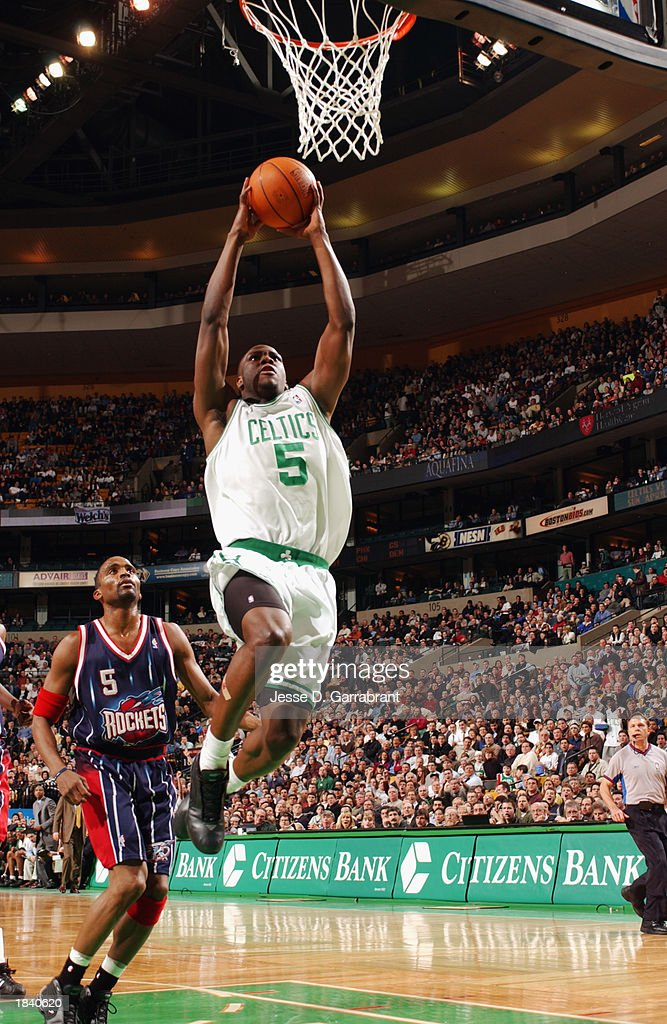 Kedrick Brown #5 of the Boston Celtics goes to the basket past Cuttino Mobley #5 of the Houston Rockets during the NBA game at Fleet Center on February 24, 2003 in Boston, Massachusetts. The Rockets won in overtime 101-95.