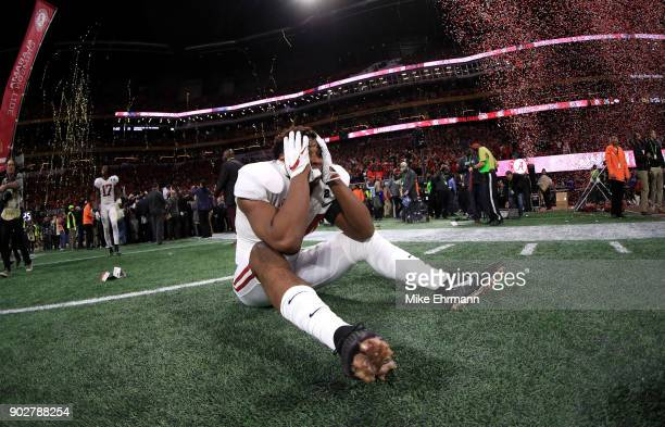 Kedrick James of the Alabama Crimson Tide celebrates beating the Georgia Bulldogs in overtime to win the CFP National Championship presented by ATT...