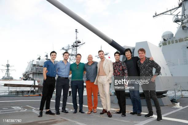 Keean Johnson Luke Kleintank Patrick Wilson Woody Harrelson Ed Skrein Darren Criss Etsushi Toyokawa and Dennis Quaid stand aboard the USS Halsey on...