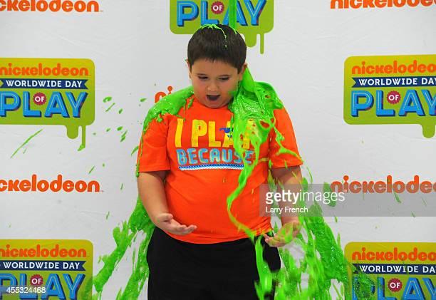 Keegan Boyle gets slimed at Nickelodeon's Worldwide Day of Play on September 12 2014 in Virginia Beach Virginia