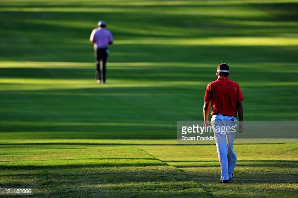 Keegan Bradley and Jason Dufner walk up the first playoff hole during the final round of the 93rd PGA Championship at the Atlanta Athletic Club on...