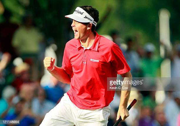 Keegan Bradley celebrates a birdie putt on the 17th green during the final round of the 93rd PGA Championship at the Atlanta Athletic Club on August...