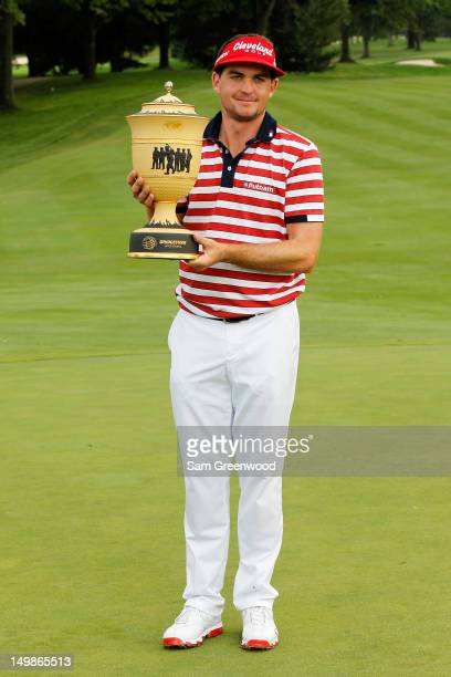 Keegan Bradley celebrates with the Gary Player trophy during the trophy presentation after winning the World Golf ChampionshipsBridgestone...