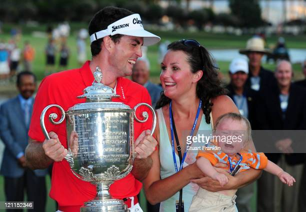 Keegan Bradley celebrates with the Wanamaker Trophy and his sister Madison and son Aiden after winning a three-hole playoff over Jason Dufner during...