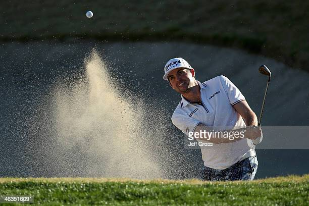 Keegan Bradley hits a bunker shot on the ninth green on the Jack Nicklaus Private Course at PGA West during the second round of the Humana Challenge...